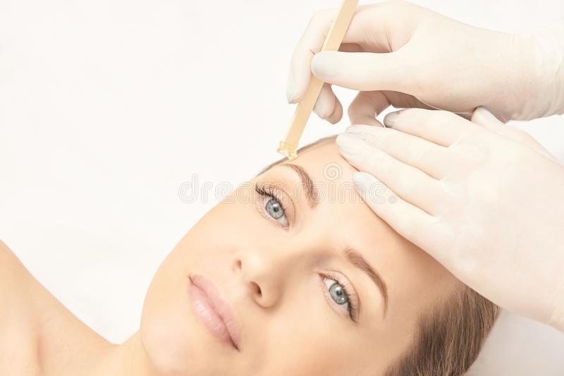 Sugar hair removal from woman body. Wax epilation spa procedure. Procedure beautician female. Eyebrow. Sugar hair removal from woman body. Wax epilation spa stock photography