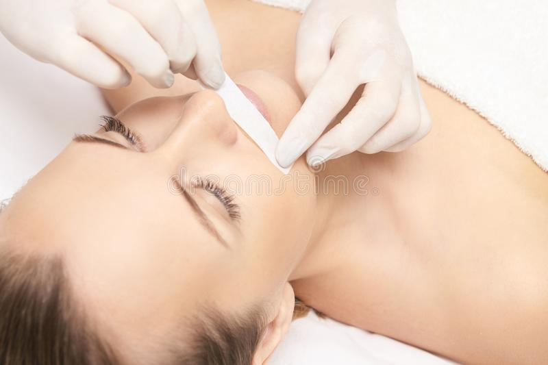Sugar hair removal from woman body. Wax epilation spa procedure. Procedure beautician female. Mustache royalty free stock image