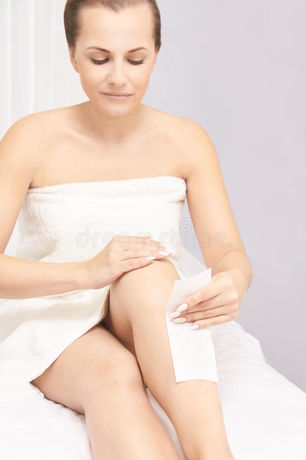 Sugar hair removal from woman body. Wax epilation spa procedure. Procedure beautician female. Leg stock images