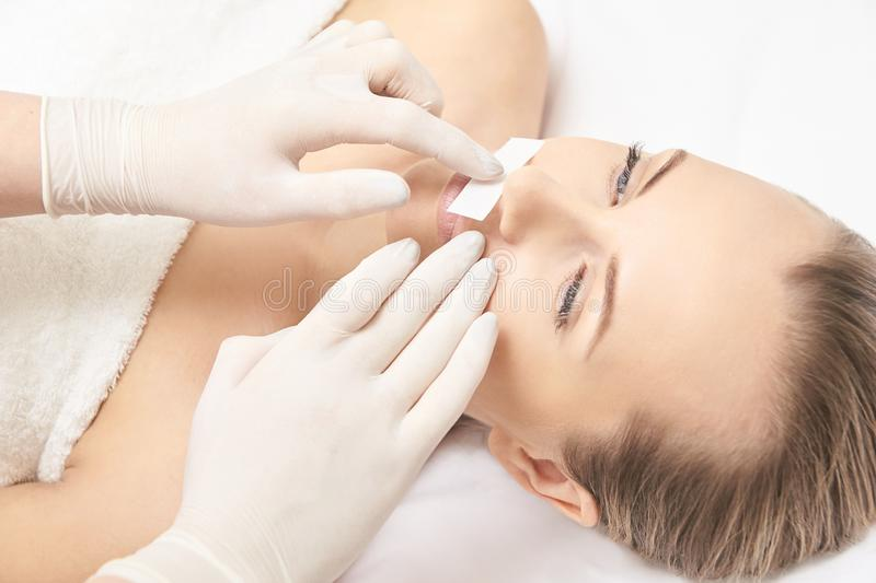 Sugar hair removal from woman body. Wax epilation spa procedure. Procedure beautician female. Mustache stock image