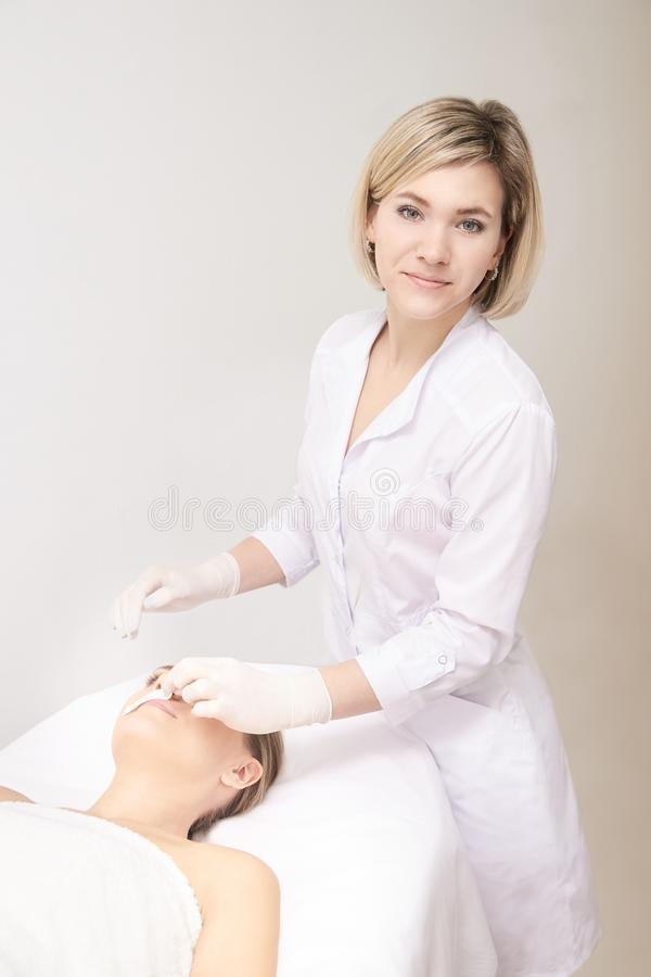 Sugar hair removal from woman body. Wax epilation spa procedure. Procedure beautician female. Mustache royalty free stock photography