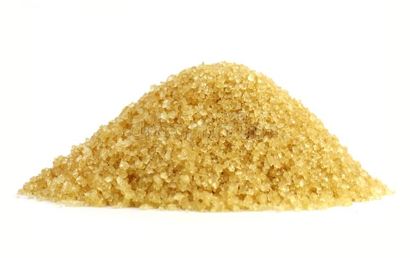 Sugar heap, Sugar mountain shape granulated sugar yellow, Pile of brown sugar from sugar cane reed, Sucrose white background stock photo