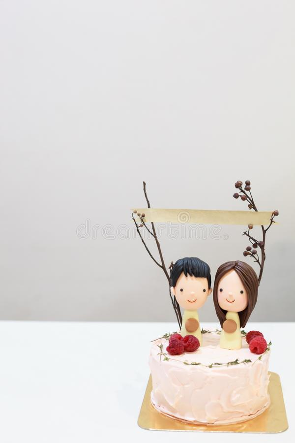 Sugar icing happy smiling couple lovers figure on delicious cake with paper banner on sticks. Birthday Celebration, Anniversary. Happiness concept royalty free stock photo