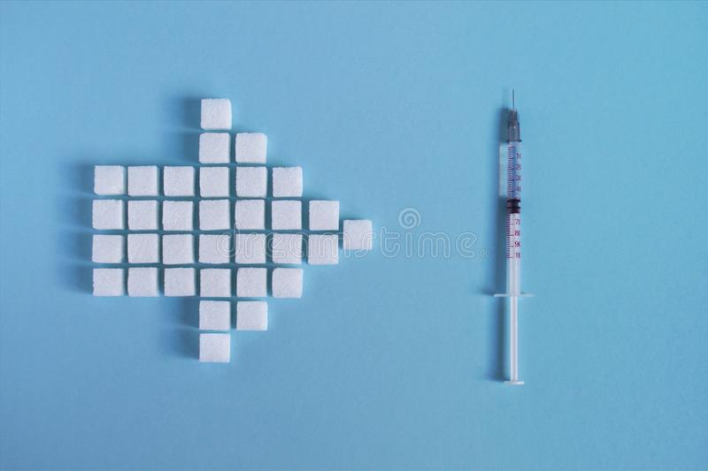 Sugar and insulin syringe stock photos