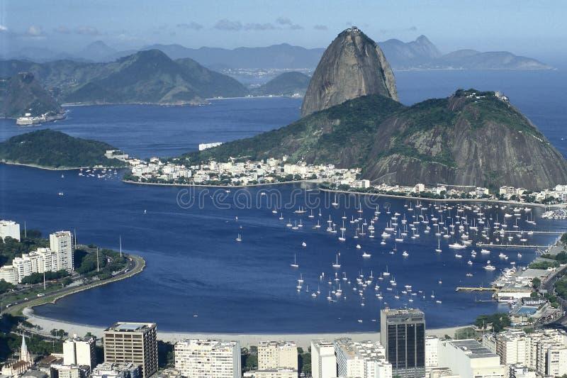 Sugar Loaf (Pão de Açucar) and Botafogo bay in Rio de Janeiro, Brazil. The Pao de Açucar (Sugar Loaf) and the Botafogo bay, dominated by the yachts and stock photo