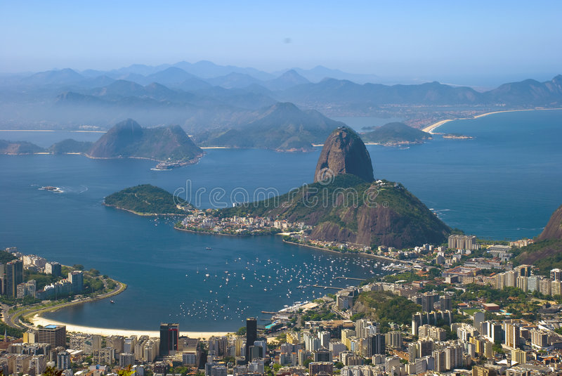 Sugar Loaf - Rio de Janeiro. The sugar loaf is the most famous postcard of Rio de Janeiro. Sugarloaf Mountain (in Portuguese, Pão de Açúcar), is a peak royalty free stock photography