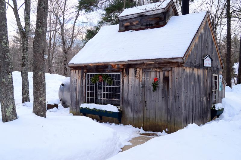 A Sugar Maple Shack at Christmas. A Sugar Maple Shack in New Hampshire stands in a snowy, cold forest royalty free stock images