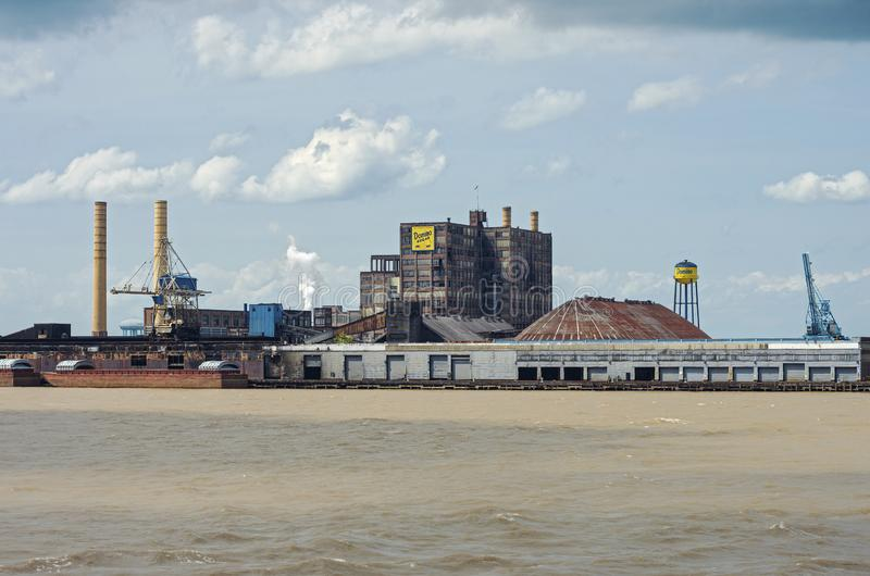 Sugar Refinery on Mississippi River in New Orleans. New Orleans, Louisiana/USA - June 14, 2019: Commercial sugar refinery along banks of Mississippi River stock photography