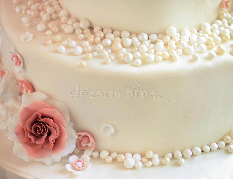 Sugar roses with pearls on the cake closeup. Sugar roses with pearl sugar pearls on the cake closeup stock images