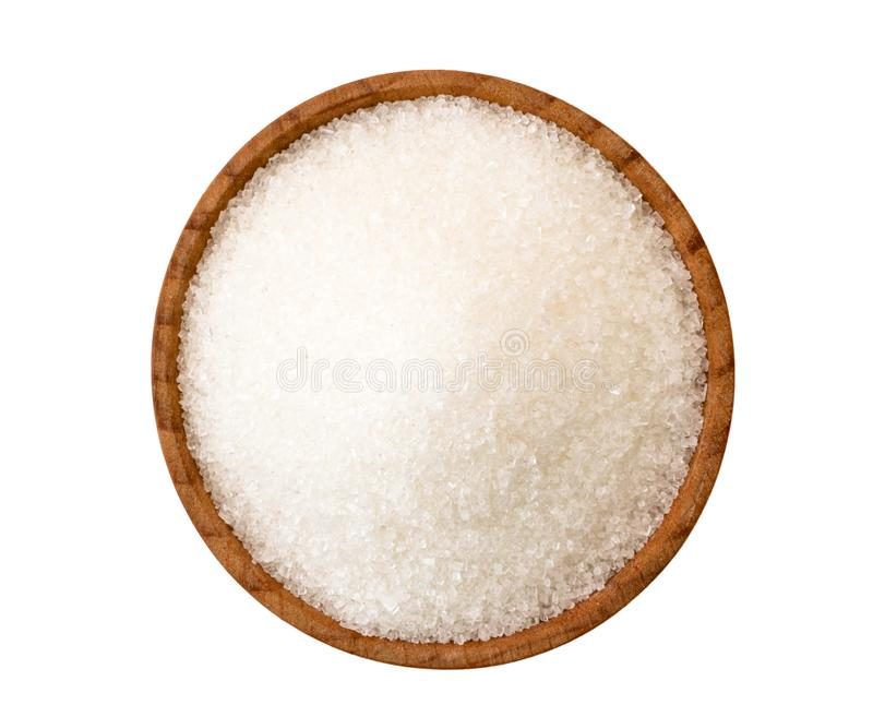 Sugar sand in wooden plate on a white. The view of the top. Sugar sand in wooden plate on a white background. The view of the top stock photo