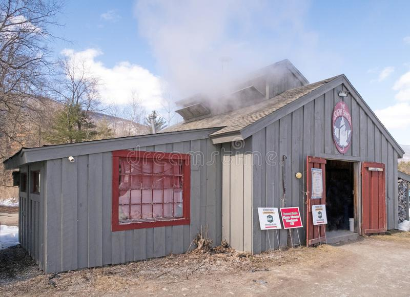 The Sugar Shack, Maple sugar shack. With smokestack during March springtime harvest, Arlington Vermont, New England during open house stock image