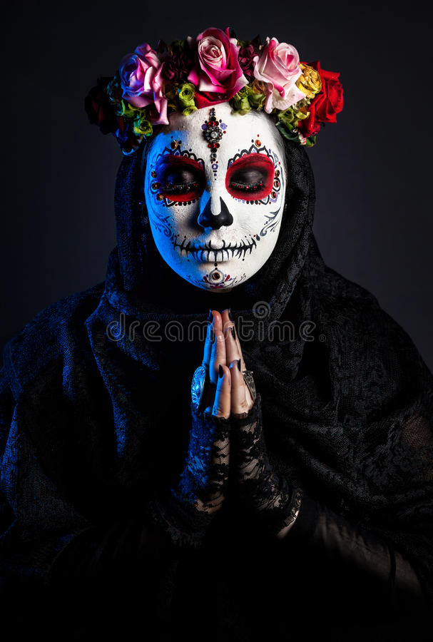 Sugar skull girl with flowers royalty free stock photos