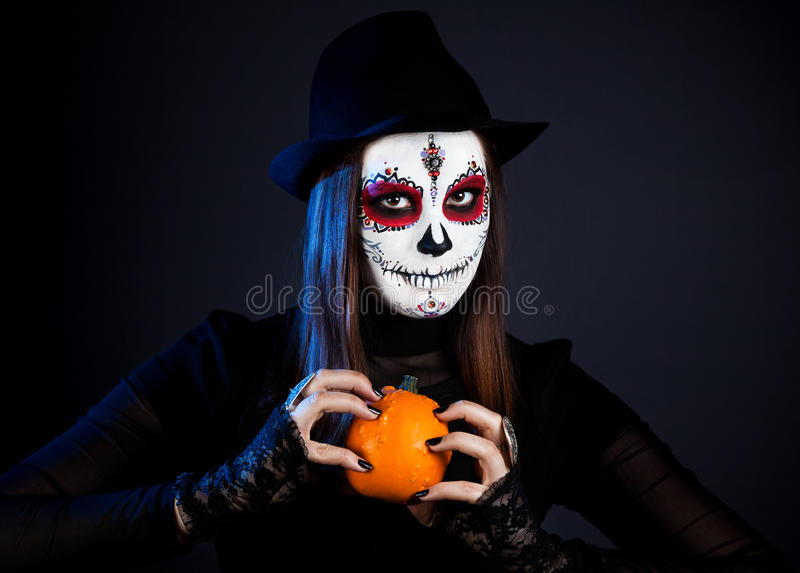 Sugar skull girl with pumpkin stock photos