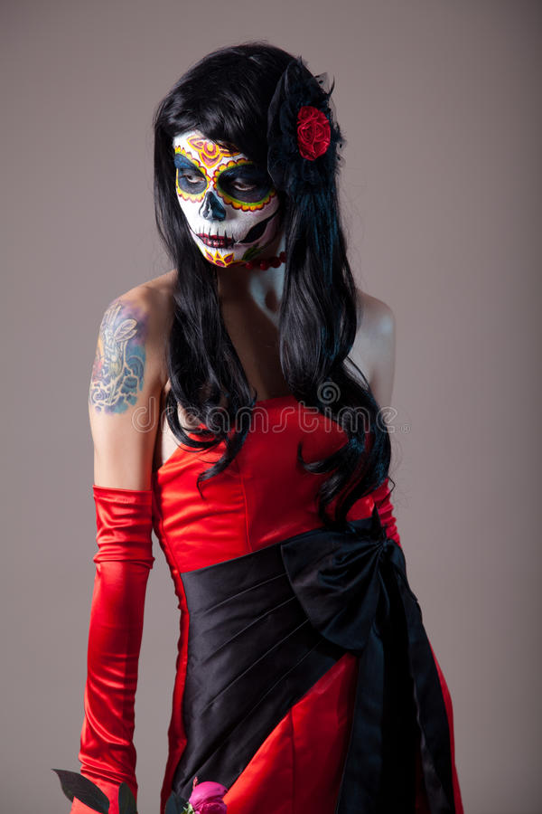 Sugar skull girl in red evening dress