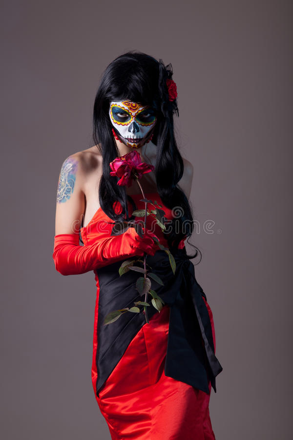Sugar skull girl with rose royalty free stock images