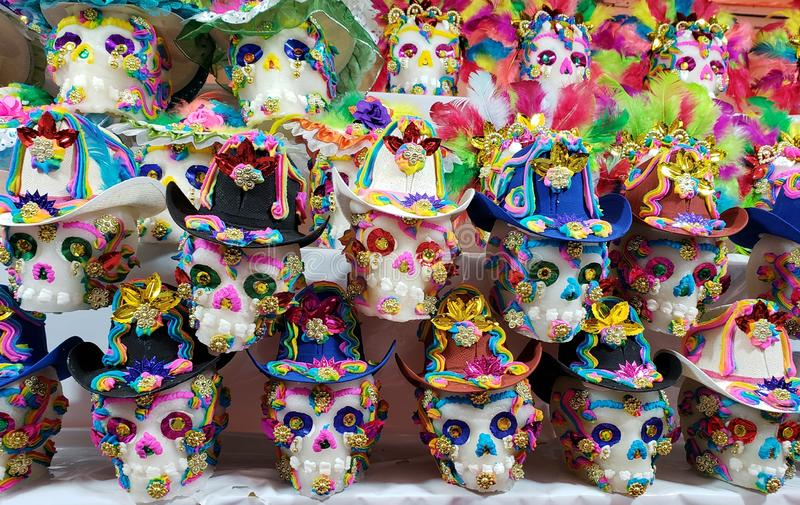 Sugar skulls decorated in a traditional mexican market to celebrate day of the dead royalty free stock photography