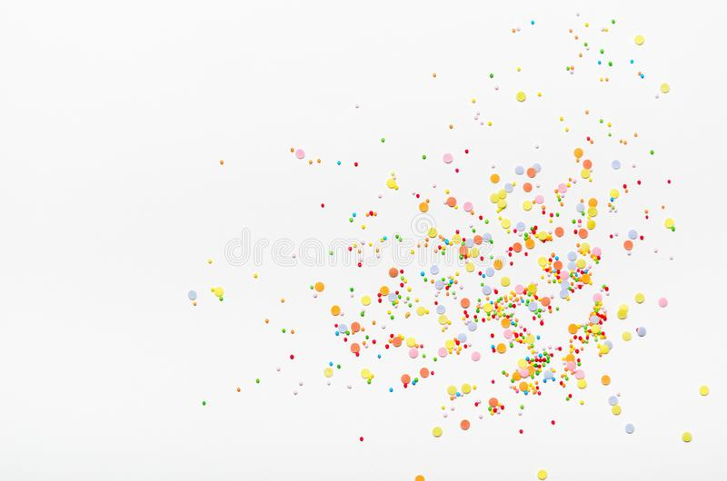 Sugar sprinkle dots on white background. Sweet decoration for cakes. Top view, copy space. Sugar sprinkle dots on white background. Sweet decoration for cakes stock photography