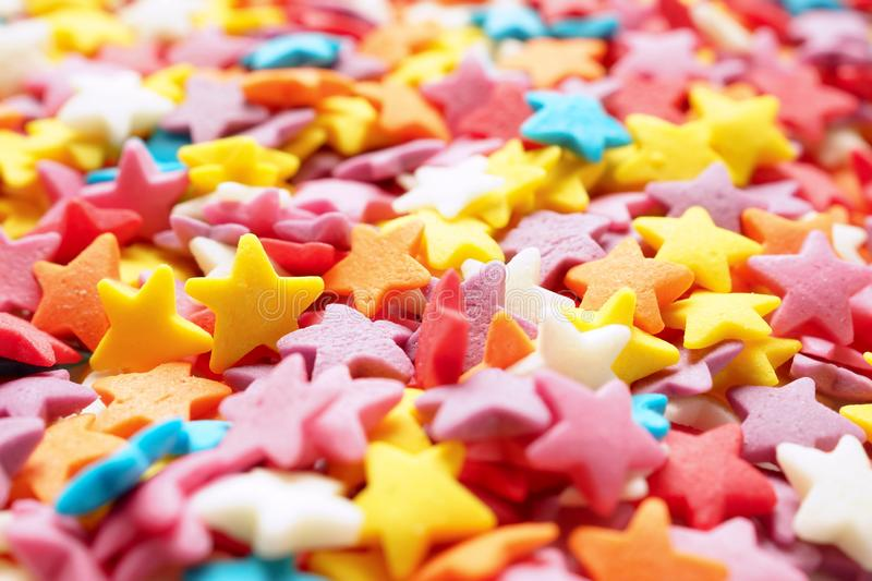 Sugar stars for baking decoration. Confectionery multi-colored topping closeup. Shallow depth of field royalty free stock photos