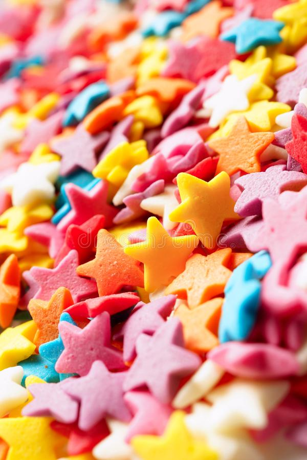 Sugar stars for baking decoration. Confectionery multi-colored topping closeup. Shallow depth of field stock photo