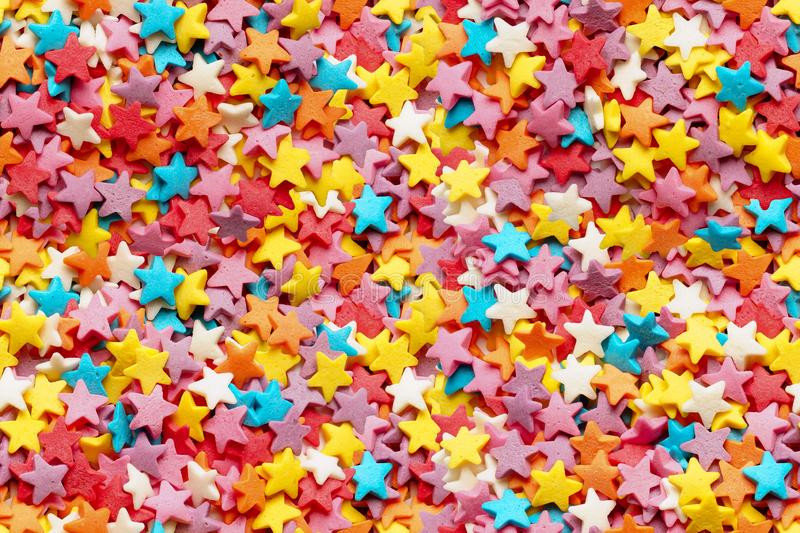 Sugar stars for baking decoration.  Seamless. Sugar stars for baking decoration. Confectionery multi-colored topping closeup. Seamless background. You can create stock photos
