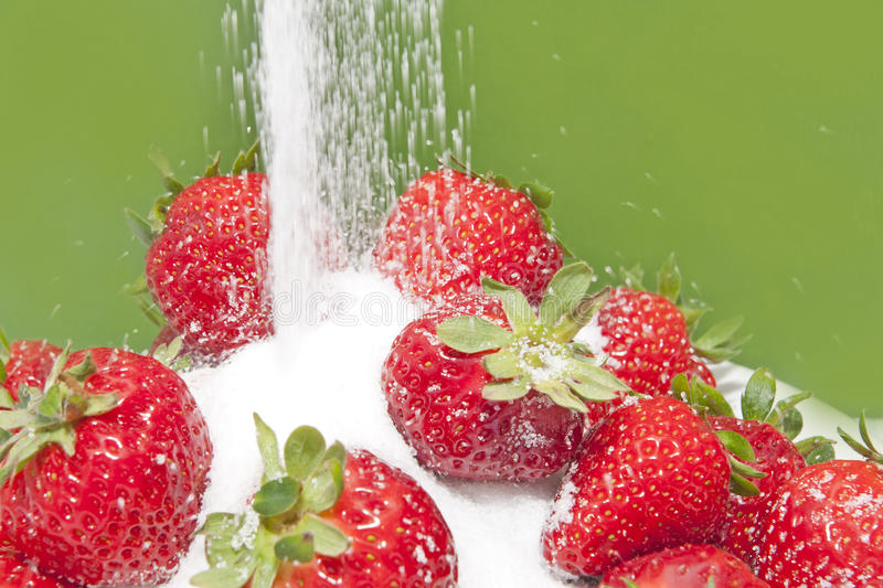 Sugar on strawberries stock image