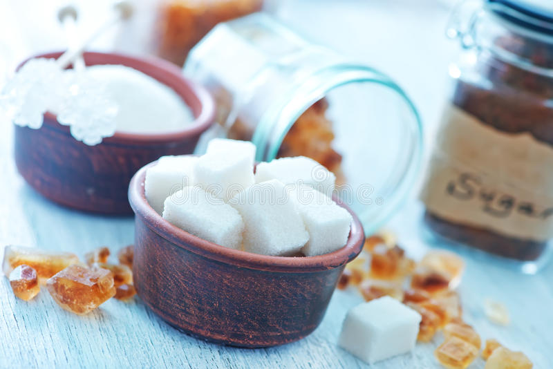 Sugar. On a table, crystal on the wooden board royalty free stock image