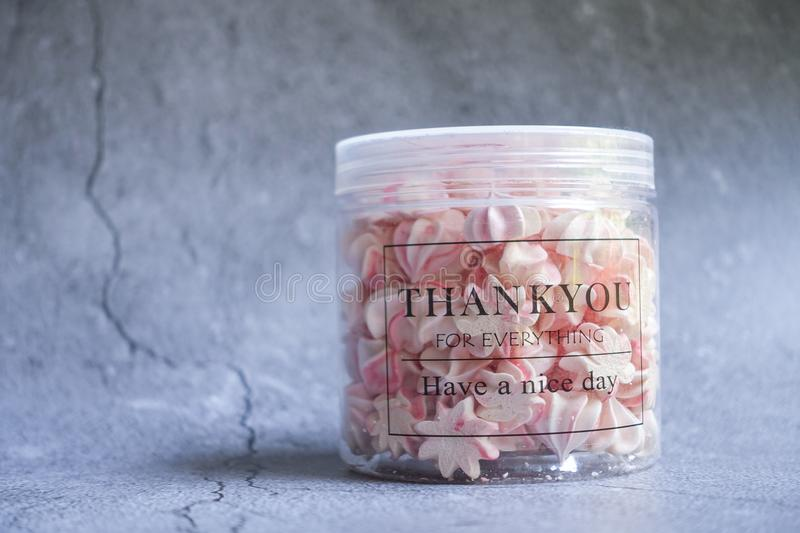 Sugar Treats Filled Plastic Jar With Thank You Print stock photo