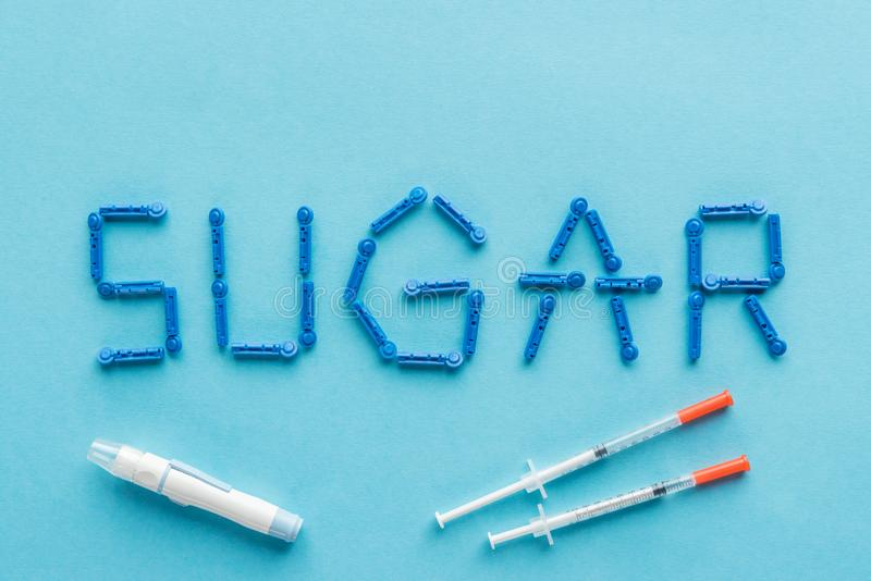 sugar word made with disposable needles and insulin syringes royalty free stock photos