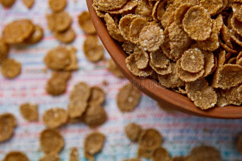 Sugarcorn flakes in a ceramic bowl closeup top view. light breakfast on the table close up. food fast cooking. healthy food, diet stock image