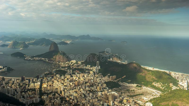 Sugarloaf mountain and copacabana beach in rio de janeiro, brazil. Late afternoon view of sugarloaf mountain and copacabana beach in rio de janeiro, brazil from royalty free stock photos