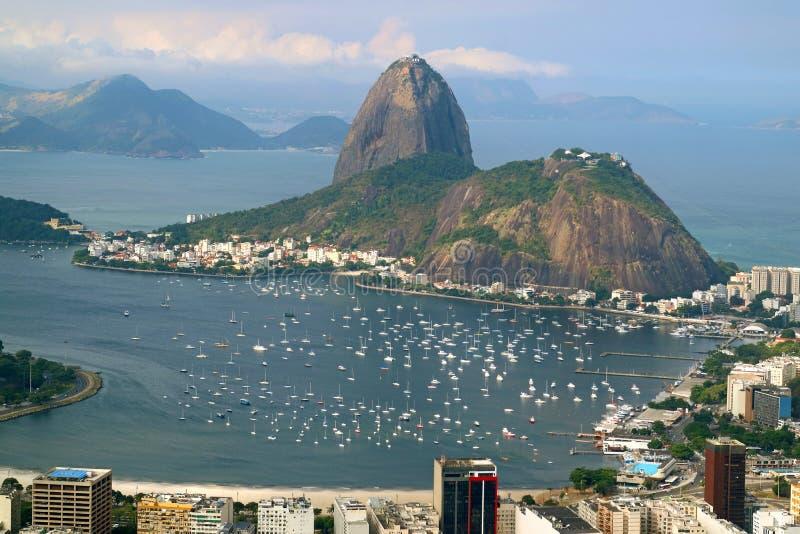 Sugarloaf Mountain or Pao de Acucar, the famous landmark of Rio de Janeiro view from Corcovado Hill in Rio de Janeiro, Brazil stock images