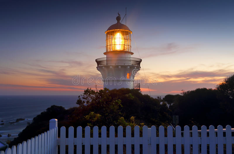 Sugarloaf Point Lighthouse at sundown. A long exposure taken after sundown of the Sugarloaf Point Lighthouse, Seal Rocks Australia stock photography