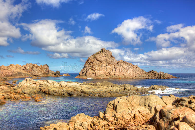 Sugarloaf Rock. A famous coastal landmark near the town of Dunsborough in South-West Australia. The rock is the world's most southerly nesting site for the Red royalty free stock images