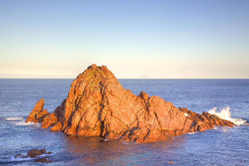 Sugarloaf Rock. First light on Sugarloaf Rock, a famous coastal landmark near the town of Dunsborough in South-West Australia. The rock is the world's most royalty free stock photos
