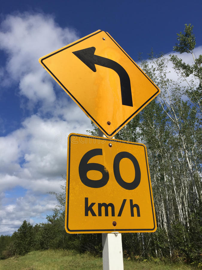 Suggested Sixty Kilometer Per Hour Sign Around Bend.  stock images