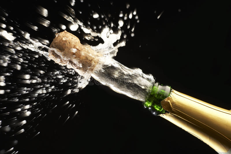 Sughero schioccante di Champagne fotografia stock