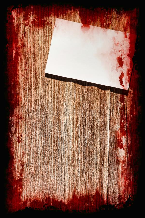 Suicide bloody note on grunge wooden background with frame.Halloween background. royalty free illustration