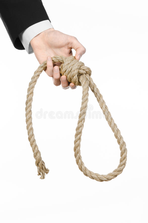 Suicide and business topic: Hand of a businessman in a black jacket holding a loop of rope for hanging on white isolated royalty free stock photography