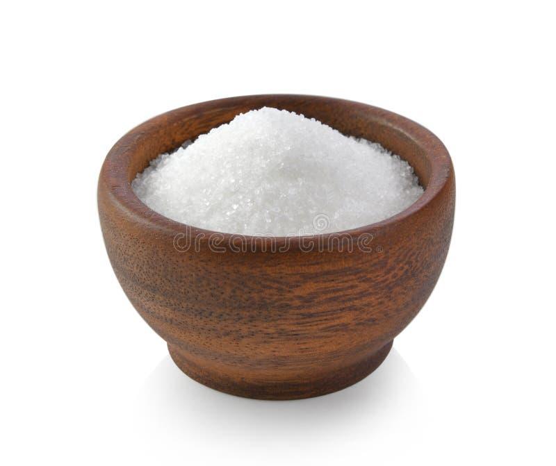 Suiker in houten kom op witte achtergrond royalty-vrije stock foto