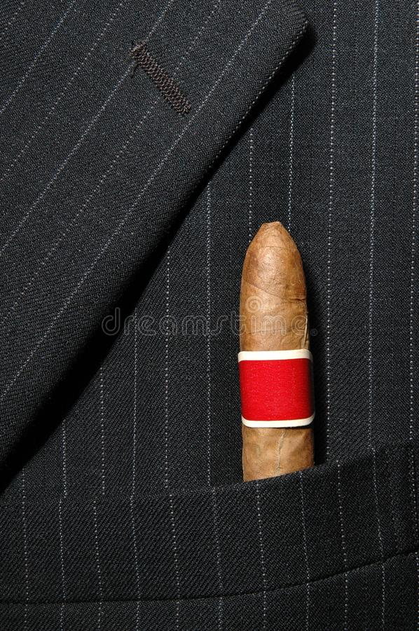 Suit and cigar. Background of suit and cigar - Please look at my portfolio other kinds exist royalty free stock photo