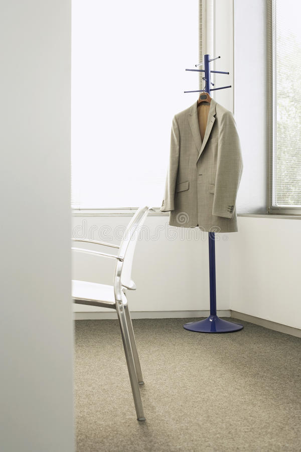Download Suit Jacket On Coat Stand In Corner Of Office Stock Photo   Image  Of Suit