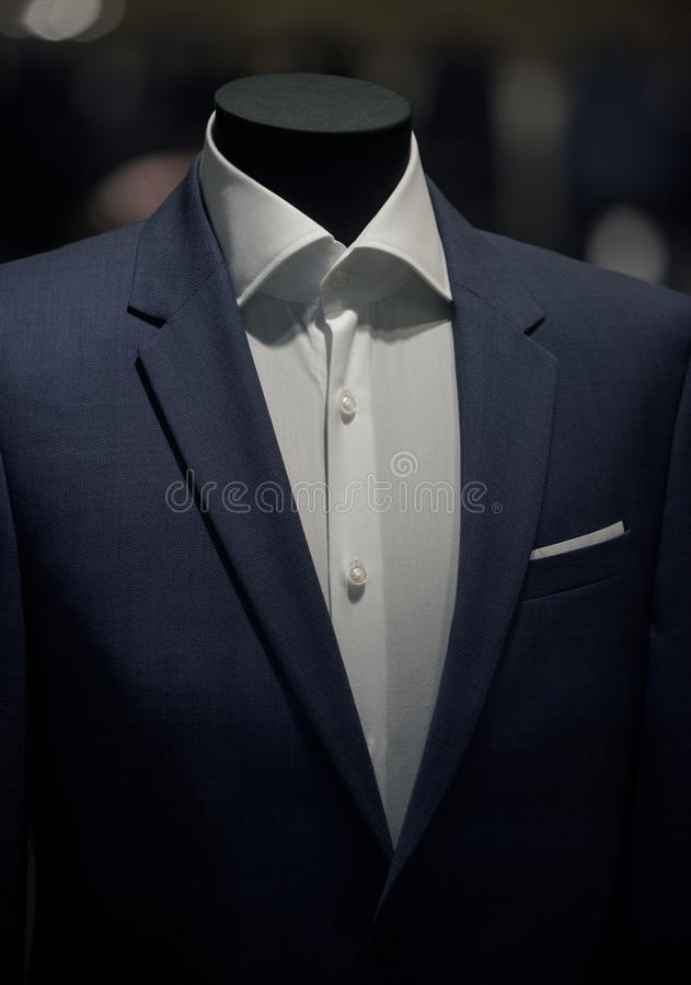 Suit jacket and white shirt on mannequin. Fashion mannequin in shop. Fashion and style. Business or formal wear royalty free stock image