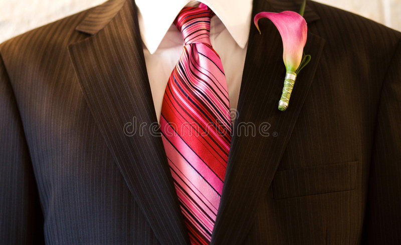 Suit with Pink Tie. Close up of a man's suit with a pink tie and flower stock photos