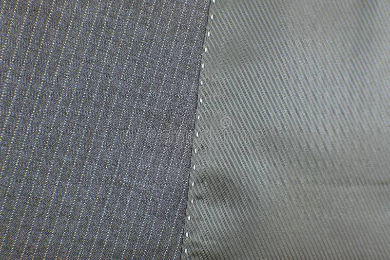 Suit texture. With seam button and pocket stock image