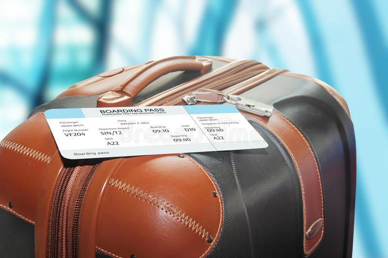 Suitcase and boarding pass in the airport royalty free stock photos