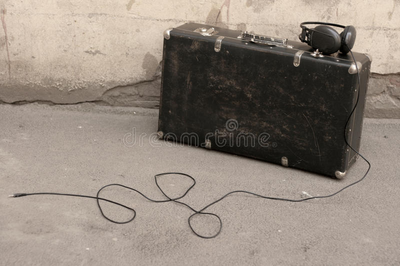 Suitcase and headphones stock images