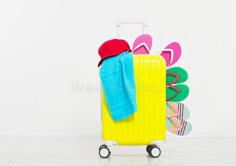 Suitcase isolated on white background Summer holidays. summer flip flops or slippers.Sandals beach.Red cap.Travel valise or bag. M stock photography
