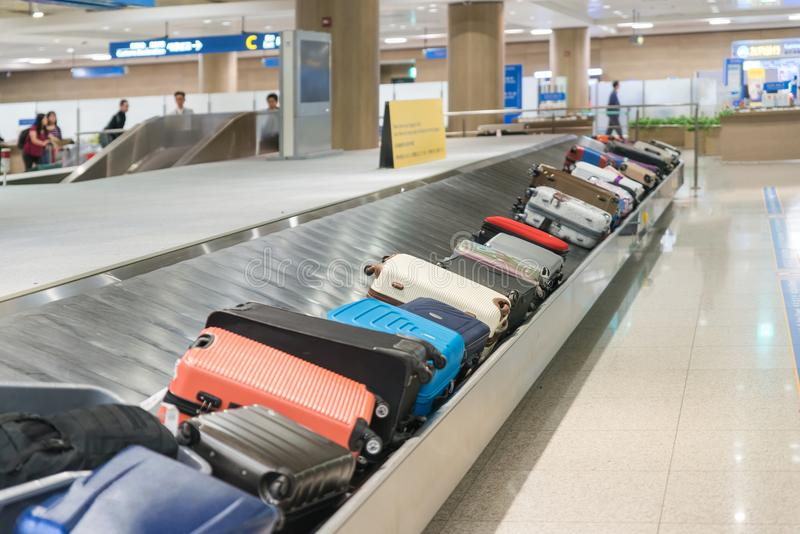 Suitcase or luggage with conveyor belt in the airport. royalty free stock images