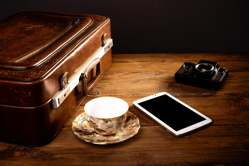 Suitcase and old camera royalty free stock images