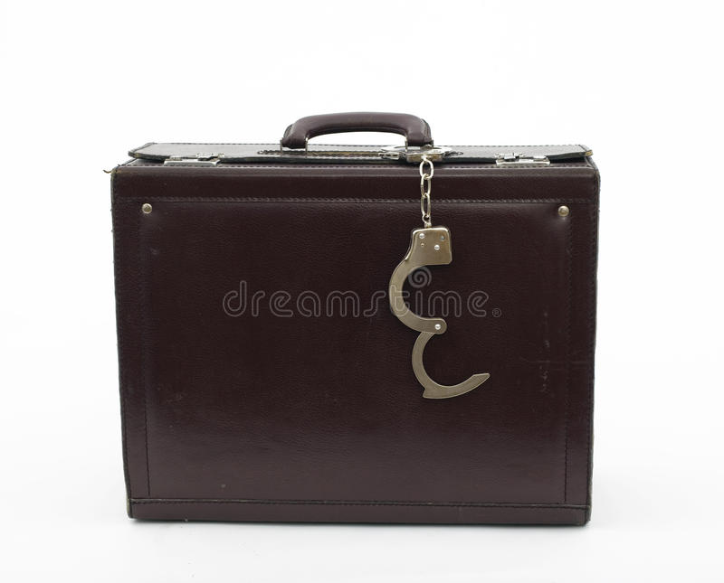 Suitcase From Pinned Open Handcuffs Royalty Free Stock Photo